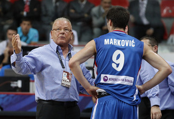 Serbia's head coach Ivkovic gives instructions to Markovic during their FIBA Basketball World Championship game against Angola in Kayseri