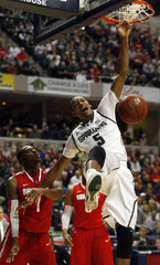 Michigan State's Payne dunks on Ohio State's Thomas during an NCAA basketball game in Indianapolis.