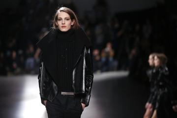 A model presents a creation by designer Anthony Vaccarello as part of his Fall/Winter 2014-2015 women's ready-to-wear collection during Paris Fashion Week