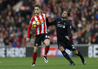 Liverpool's Emre Can in action with Sunderland's Adnan Januzaj