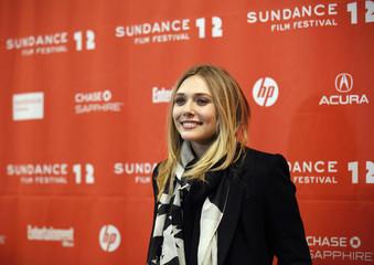 "Cast member Elizabeth Olsen poses at the premiere of the film ""Red Lights"" during the Sundance Film Festival in Park City, Utah"