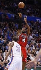 Miami Heat forward LeBron James shoots against Oklahoma City Thunder forward Kevin Durant in the first half of their NBA basketball game in Oklahoma City.