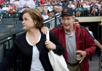 "Former U.S. President George H.W. Bush arrives with daughter Dorothy ""Doro"" Bush Koch for opening night of the MLB season in Houston"
