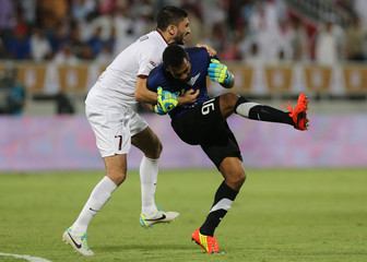 El-Jaish's captain Rizik and team mate AlKhater celebrate after the match against Lekhwiya during their final Qatar Cup soccer in Doha