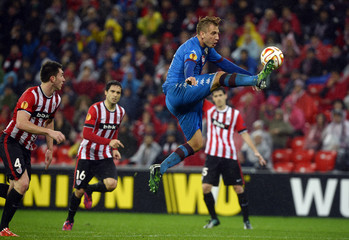 Torino's Maxi Lopez leaps in the air during their Europa League round of 32 second leg soccer match against Athletic Bilbao at San Mames stadium in Bilbao