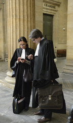 French lawyers Dupin and Laffont, who represent Patrick de Maistre, L'Oreal SA heiress Liliane Bettencourt's former wealth manager, are seen in the court of appeals in Bordeaux
