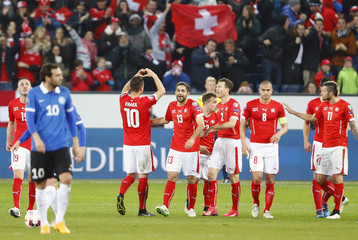 Xhaka of Switzerland celebrates his goal against Estonia with team mates during their Euro 2016 Group E qualifying soccer match at Swisspore arena in Luzern
