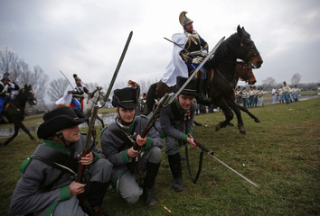 People dressed as Austrian soldiers of the Habsburg dynasty attend the re-enactment of the battle against Hungary in Tapiobicske