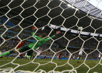 Ghana's Gyan shoots to score a goal past Germany's Neuer during their 2014 World Cup Group G soccer match at the Castelao arena in Fortaleza