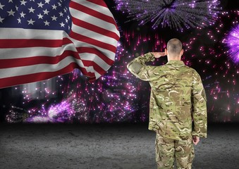 soldier in front of fireworks with usa flag