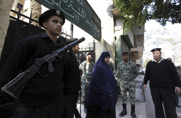 Soldiers and policemen maintain order during parliamentary run-off elections at Shubra in El-Kalubia, on the outskirts of Cairo