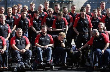 Britain's Prince Harry poses with members of the British Armed Forces Invictus Team during the British Armed Forces team announcement for the Invictus Games, in London