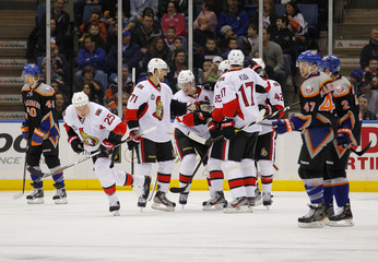 Ottawa Senators center Jason Spezza is congratulated by teammates after scoring against the New York Islanders in first period action of their NHL hockey game in Uniondale