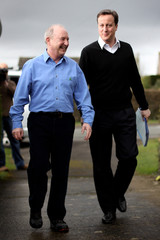 Cancer sufferer Stone walks with Conservative Party leader Cameron outside his house in Witney