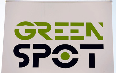 The logo of the Green Spot's recharging station of Enersoft company, the first service station for electric cars on a Carrefour hypermarket's parking, is pictured in Bordeaux