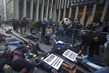 """Demonstrators stage a """"die in"""" in front of News Corporation's New York office in Manhattan"""