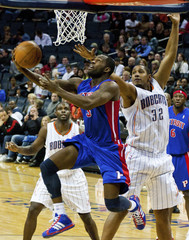 Detroit Pistons Stuckey works to shoot around Charlotte Bobcats power forward Diaw of France during an NBA basketball game in Charlotte