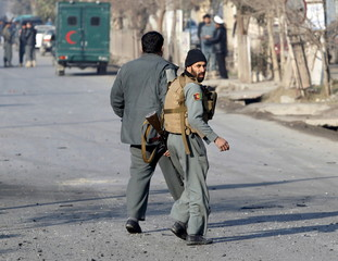Afghan police arrive after a blast near the Pakistani consulate in Jalalabad