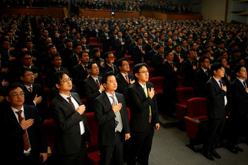 Employees of Hyundai Motor salute to the national flag during the company's New Year ceremony in Seoul
