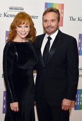 Country singer McEntire and her husband Blackstock pose on the red carpet as they arrive ahead of the 37th Annual Kennedy Center gala dinner at the U.S. State Department, in Washington