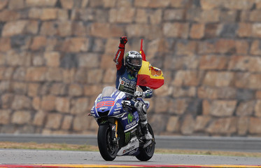 Yamaha MotoGP rider Lorenzo of Spain celebrates his victory in the Aragon Motorcycling Grand Prix at Motorland race track in Alcaniz