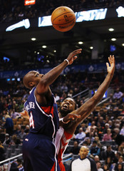 Toronto Raptors' Johnson goes for a rebound against Atlanta Hawks' Tolliver during their NBA basketball game in Toronto