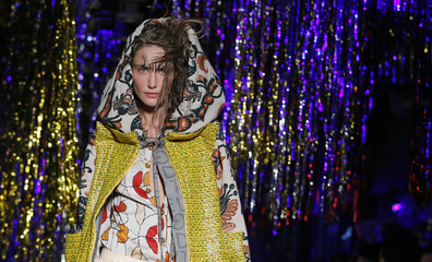 A model presents a creation by British designer Vivienne Westwood as part of her Autumn/Winter 2015/2016 women's ready-to-wear collection during Paris Fashion Week