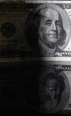 A picture illustration shows a U.S. 100 dollar bank note bearing an image of Benjamin Franklin taken in Tokyo