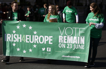 Participants carry a banner as they take part in the St. Patrick's Day Parade in central London
