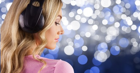 Blond-hair girl listenning music with headphones