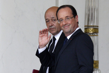 France's President Hollande and newly named Defence Minister Drian walks at the end of first cabinet meeting of the new government at the Elysee Palace in Paris
