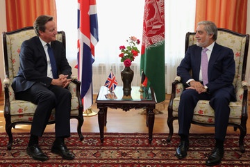 Britain's Prime Minister David Cameron meets with Chief Executive Officer Abdullah Abdullah during a bilateral meeting at the presidential palace in Kabul, Afghanistan