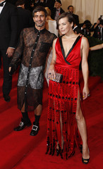 Designer Marc Jacobs and actress Milla Jovovich arrive at the Metropolitan Museum of Art Costume Institute Benefit in New York