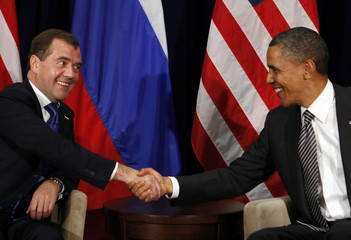 U.S. President Obama shakes hands with Russian President Medvedev during APEC Summit in Hawaii