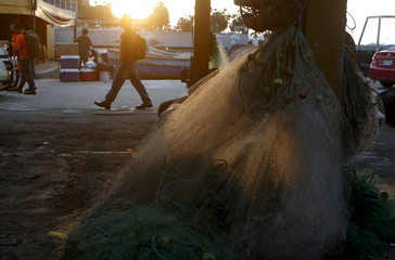 Fishing nets are seen at a market at Pescadores beach in the Chorrillos district of Lima