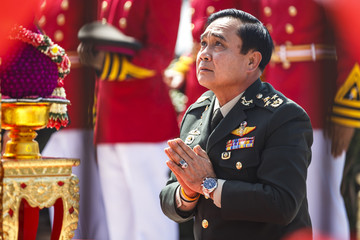 Thailand's Prime Minister Prayuth Chan-ocha prays before a military parade marking his retirement as commander in chief of the Royal Thai Army at the Chulachomklao Royal Military Academy in Nakornnayok
