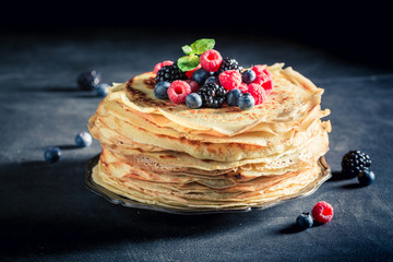 Delicious stack of pancakes with blueberries and raspberries