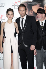 """Cast members Marion Cotillard and Matthias Schoenaerts and director Jacques Audiard arrive at the """"Rust and Bone"""" Gala Screening during AFI Fest at Grauman's Chinese Theater in Hollywood, California"""