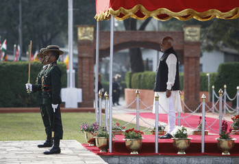India's Prime Minister Narendra Modi watches a guard of honour upon his arrival for the 18th South Asian Association for Regional Cooperation (SAARC) summit in Kathmandu