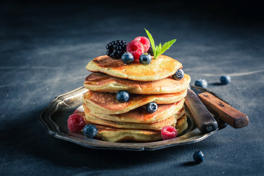 Homemade american pancakes with blueberries and raspberries
