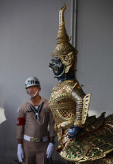 A Thai Navy officer stands behind a Royal Barge during a worship ceremony which is a sacred ritual for the Royal Barge Procession at the Royal Barges National Museum in Bangkok