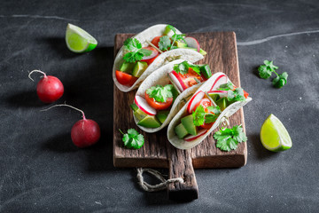 Mexican tacos with cherry tomatoes and radish