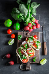 Vegetarian tacos with avocado and fresh coriander