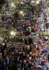 People shop at Al Ataba in downtown Cairo