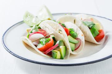 Delicious tacos with avocado and fresh coriander