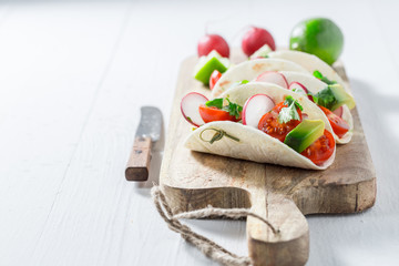 Vegetarian tacos with fresh vegetables and lime