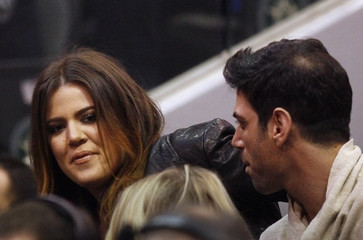 Celebrity Khloe Kardashian watches the NBA basketball game between the Mavericks and the Heat in Dallas, Texas
