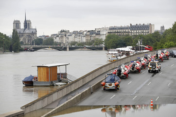 Emergency inflatable boats are parked with the Notre-Dame Cathedral in the background as high waters cover the banks of the Seine River in Paris