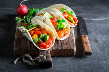 Tasty tacos with spicy chicken and fresh vegetables