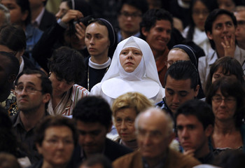 A nun looks on as Pope Benedict XVI leads a ceremony at the Basilica of St. John Lateran in Rome